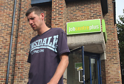 FILE PICTURE © licensed to London News Pictures. LONDON, UK.  UK unemployment figures released today FILE PICTURE 17/08/11. Dartford, UK. A man leaving the Job Centre Plus in Dartford, Kent today (17/08/2011). Photo credit : Andy Barnes/LNP
