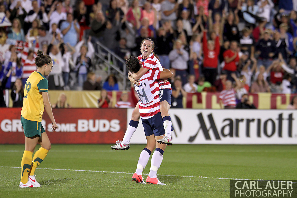September 19, 2012 Commerce City, CO.  USA m Heather O'Reilly (9) jumps into the arms of Abby Wambach (14) after O'Reilly scored the first goal of the Soccer Match between the USA Women's National Team and the Women's Australian team at Dick's Sporting Goods Park in Commerce City, Colorado