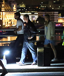 Model Suki Waterhouse meets up with her actor boyfriend Bradley Cooper while he was filming a scene of his latest film Adam Jones on Waterloo Bridge in London, UK. 31/07/2014<br />