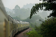 Eastern & Oriental Express. The train passing through the jungle at dawn.