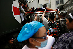 A Chinese woman is brought out on a stretcher in a hospital in Lushan County of Ya'an,Sichuan Province, China, 21 April 2013. The Lushan Earthquake in Sichuan Province on 20 April 2013 resulted in 186 people dead, 21 missing, 11248 injured. About 1.72 million people were affected by the quake, while an initial estimate by the International Red Cross on Saturday put the number needing emergency shelter, water and food at 120,000. The China Earthquake Administration (CEA) recorded a magnitude 7.0 earthquake, while the US Geological Survey said it had measured 6.9.