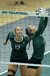 23 September 2017:  Maddie Williams & Kira Jackson during an NCAA womens division 3 Volleyball match between the Tufts Jumbos and the Illinois Wesleyan Titans in Shirk Center, Bloomington IL