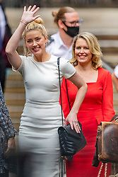 © Licensed to London News Pictures. 27/07/2020. London, UK. American actress AMBER HEARD leaves the High Court in London, where Johnny Depp is in a legal dispute with UK tabloid newspaper The Sun over allegations he assaulted his former wife, Amber Heard. Photo credit: Vudi Xhymshiti/LNP
