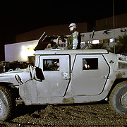 A military vehicle guards the motorcade of Pres. Bush during a dinner with troops of the 1st Armor Division in a mess hall at Baghdad International Airport Thursday, November 27, 2003.  In a clandestine night time move President Bush, with the knowledge of only a handful of senior staff, departed his ranch in Crawford, Texas and flew through the night to spend the Thanksgiving Day holiday visiting troops stationed in the war torn country...Photo by Khue Bui