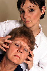 Leona Davide does shiatsu massage specialising in women with menstrual problems, Putney, London, May 12, 2000. Photo by Andrew Parsons / i-images..