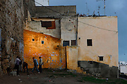 Medina, Tangier, Morocco pictured on December 18, 2009. Boys mooch around a semi-derelict area of the Old Town, which is picturesque with its old walls in earth colours, but evidently a tough environment for these young people. Tangier, the 'White City', gateway to North Africa, a port on the Straits of Gibraltar where the Meditaerranean meets the Atlantic is an ancient city where many cultures, Phoenicians, Berbers, Portuguese and Spaniards have all left their mark. With its medina, palace and position overlooking two seas the city is now being developed as a tourist attraction and modern port. Picture by Manuel Cohen