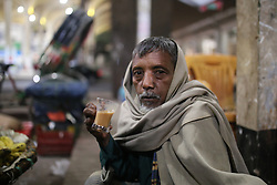 December 19, 2018 - Dhaka, Bangladesh - A Bangladeshi man takes tea at a street tea stall during cold weather in Dhaka, Bangladesh. More than 100 million people are expected to cast their votes in the upcoming general election which is will be held on December 30, 2018. (Credit Image: © Rehman Asad/NurPhoto via ZUMA Press)