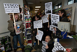 © licensed to London News Pictures. London, UK 18/02/2012. Right to Work campaigners protesting outside a Tesco store in Portcullis House, Westminster after the chain mistakenly posted an advert for permanent workers in exchange for expenses and jobseeker's allowance. Photo credit: Tolga Akmen/LNP