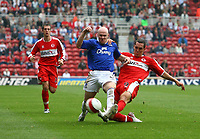 Photo: Andrew Unwin.<br />Middlesbrough v Everton. The Barclays Premiership. 14/10/2006.<br />Middlesbrough's Emanuel Pogatetz (R) looks to tackle Everton's Andy Johnson (C).