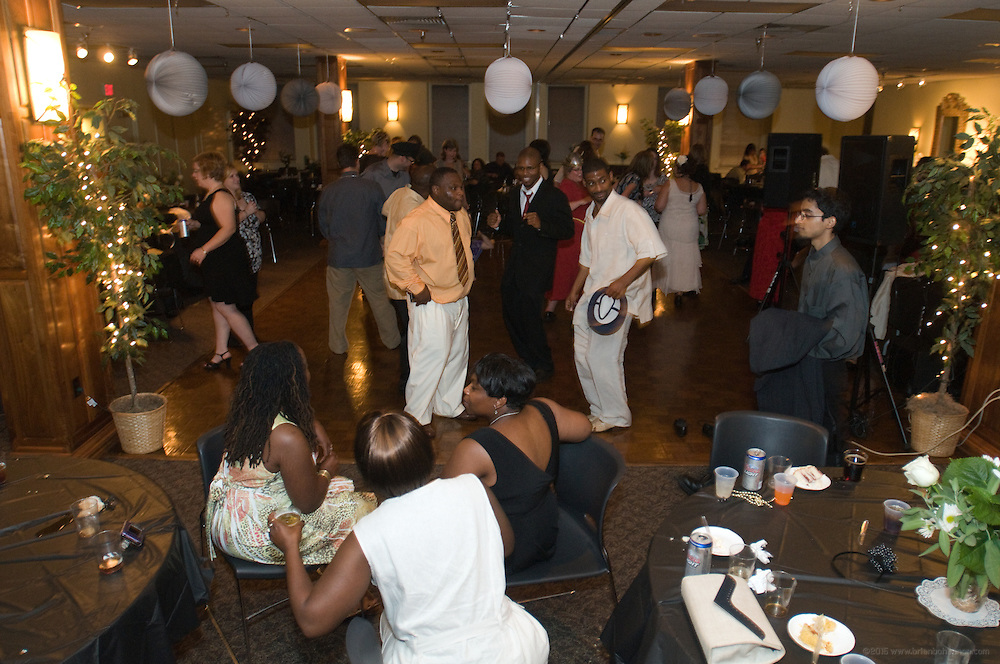 The cocktail party - style wedding of Melissa Amos and Michael L. Jones Aug. 7, 2009 at The Old Medical School Building in Louisville, Ky. (Photo by Brian Bohannon)