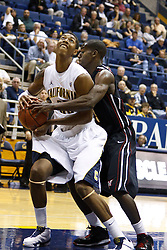November 16, 2010; Berkeley, CA, USA;  California Golden Bears forward Richard Solomon (25) is fouled by Cal State Northridge Matadors forward Lenny Daniel (5) during the first half at Haas Pavilion.