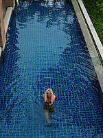 Young Woman in Bikini by Swimming Pool