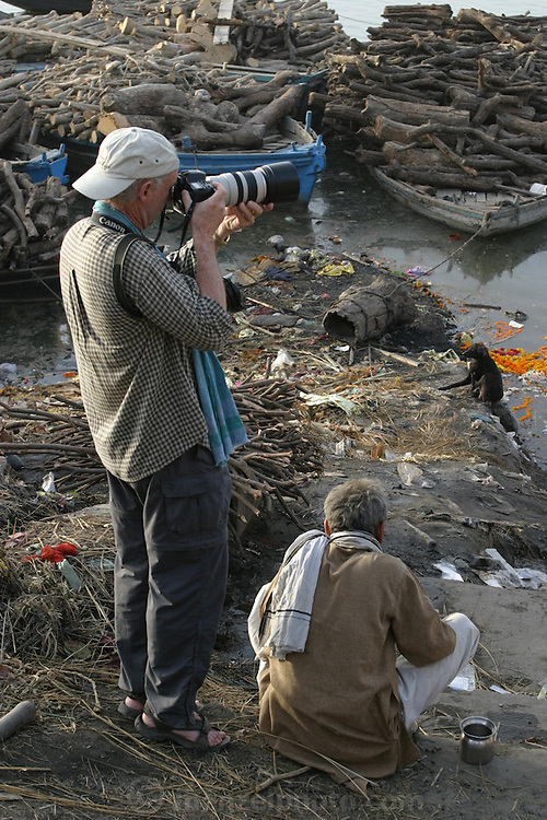 Peter Menzel photographing at Manikarnika Ghat on the Ganges River in Varanasi India. TheBodies arrive day and night from far and near to be cremated at Jalasi Ghat, the cremation grounds at Manikarnika Ghat.