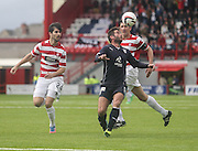 Peter MacDonald keeps his eye on the ball as Hamilton Academical's Jesus Garcia Tena and Martin Canning watch - Hamilton v Dundee, SPFL Championship at <br /> New Douglas Park<br /> <br />  - &copy; David Young - www.davidyoungphoto.co.uk - email: davidyoungphoto@gmail.com