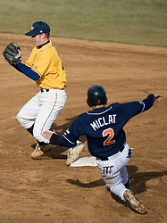 Virginia Cavaliers infielder Greg Miclat (2) tries to disrupt a double play by George Washington.  The Virginia Cavaliers Baseball Team defeated the George Washington University Colonials 15-2 to complete a sweep of the three game series on February 19, 2007 at Davenport Field, Charlottesville, VA.