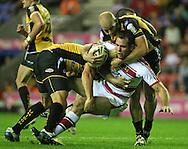 Wigan - Sunday 20th September 2009:Pat Richards of the Wigan Warriors is tackled by James Evans of the Castleford Tigers  during the Engage Super League Elimination Playoff match between The Wigan Warriors & The Castleford Tigers at the DW Stadium in Wigan. (Pic by Steven Price/Focus Images)
