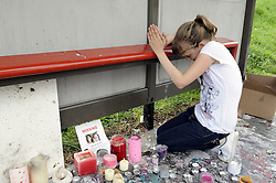© Licensed to London News Pictures. 09/08/2012 . A girl gives a little prayer at  bus stop near Castle Hill School and The Lindens..Sixth day (09.08.2012) Tia Sharp has been missing..  12 years old Tia Sharp has been missing from the Lindens on The Fieldway Estate in New Addington,Croydon,Surrey since Friday last week. .Photo credit : Grant Falvey/LNP