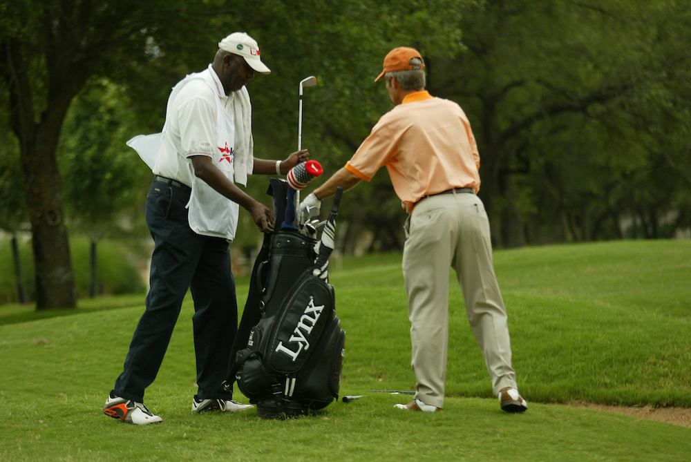 Carl Jackson, caddie for Ben Crenshaw..2003 Kinko's Classic of Austin..The Hills Country Club, Lakeway, TX..Final Round..Sunday, May 11 2003..Photograph by Darren Carroll