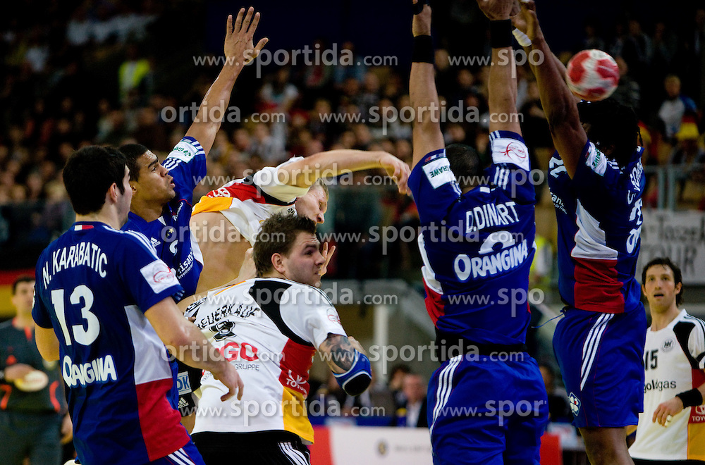 Lars Kaufmann of Germany vs Didier Dinart of France and Cedric Sorhaindo of France during the Men's Handball European Championship Main Round match between Germany and France at the Olympia Hall on January 24, 2009 in Innsbruck, Austria. (Photo by Vid Ponikvar / Sportida) - on January 2010