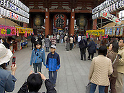 Japanese family takes a picture with cell phone in front of Asakusa Kannon Temple Tokyo