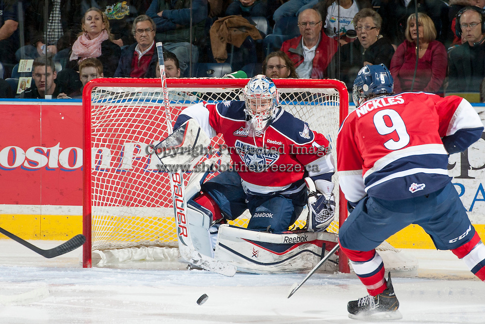 KELOWNA, CANADA - MARCH 23: Eric Comrie #1 of the Tri-City Americans defends the net against the Kelowna Rockets on March 23, 2014 at Prospera Place in Kelowna, British Columbia, Canada.   (Photo by Marissa Baecker/Shoot the Breeze)  *** Local Caption *** Eric Comrie;