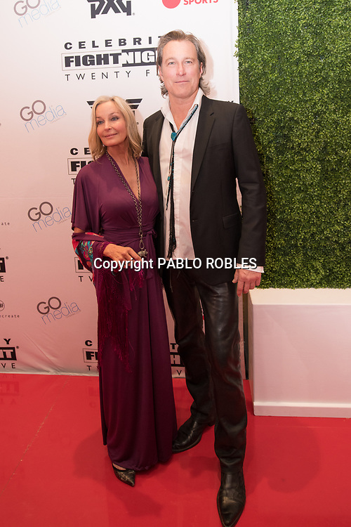 Bo Derek and John Corbett attend the Celebrity Fight Night event on March 23, 2019 in Scottsdale, AZ.