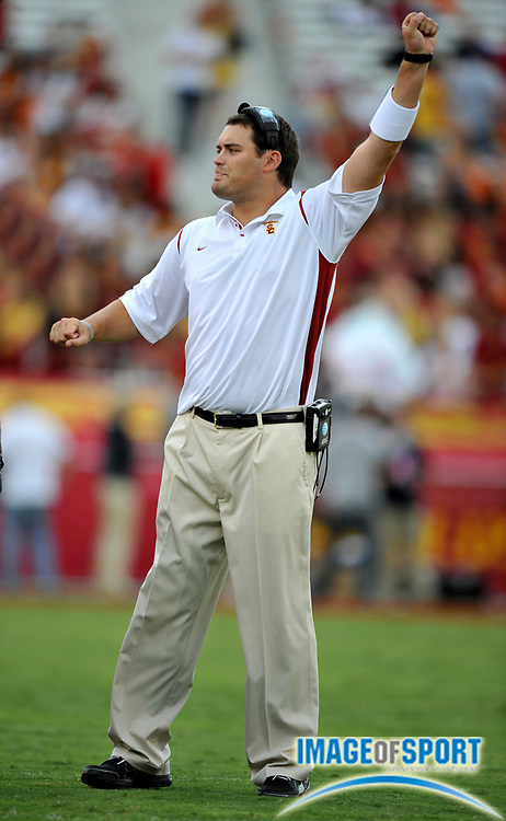 Nov 1, 2008; Los Angeles, CA, USA; Southern California Trojans tight ends coach Brennan Carroll gestures from the sidelines during game against the Washington Huskies at the Los Angeles Memorial Coliseum. Brennan is the son of head coach Pete Carroll.