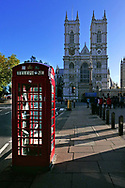 British phone booth with Westminister Abby in the background. Photo by Dennis Brack