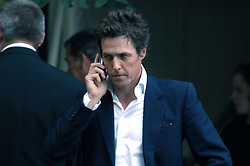 Actor HUGH GRANT at Sir David & Lady Carina Frost's annual summer party held in Carlyle Square, London on 6th July 2004.