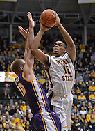 WICHITA, KS - JANUARY 05:  Forward Darius Carter #12 of the Wichita State Shockers puts up a shot against forward Seth Tuttle #10 of the Northern Iowa Panthers during the first half on January 5, 2014 at Charles Koch Arena in Wichita, Kansas.  (Photo by Peter Aiken/Getty Images) *** Local Caption *** Darius Carter;Seth Tuttlw