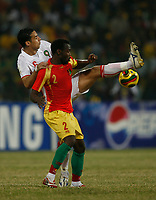 Photo: Steve Bond/Richard Lane Photography.<br /> Guinea v Morocco. Africa Cup of Nations. 24/01/2008. Elamin Erbate (L) goes for a high ball behind Pascale Feindounou (front)