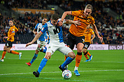 Tom Eaves of Hull City battles with Darragh Lenihan of Blackburn Rovers  during the EFL Sky Bet Championship match between Hull City and Blackburn Rovers at the KCOM Stadium, Kingston upon Hull, England on 20 August 2019.