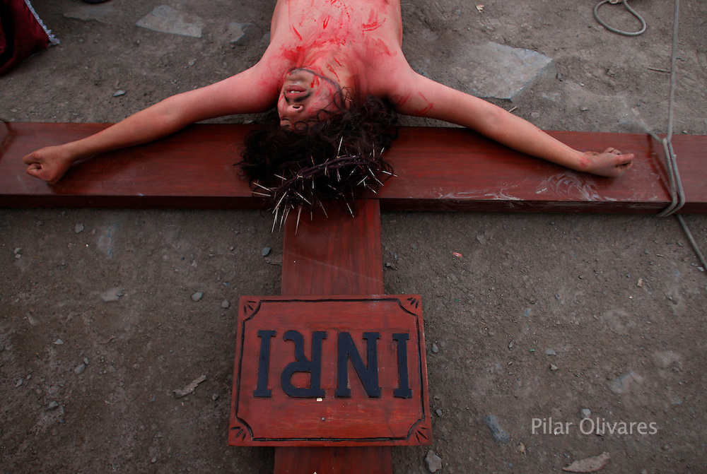 An actor playing the role of Jesus Christ performs in an re-enactment of the crucifixion of Jesus Christ on Good Friday during Holy Week on the outskirts of Lima April 2, 2010.