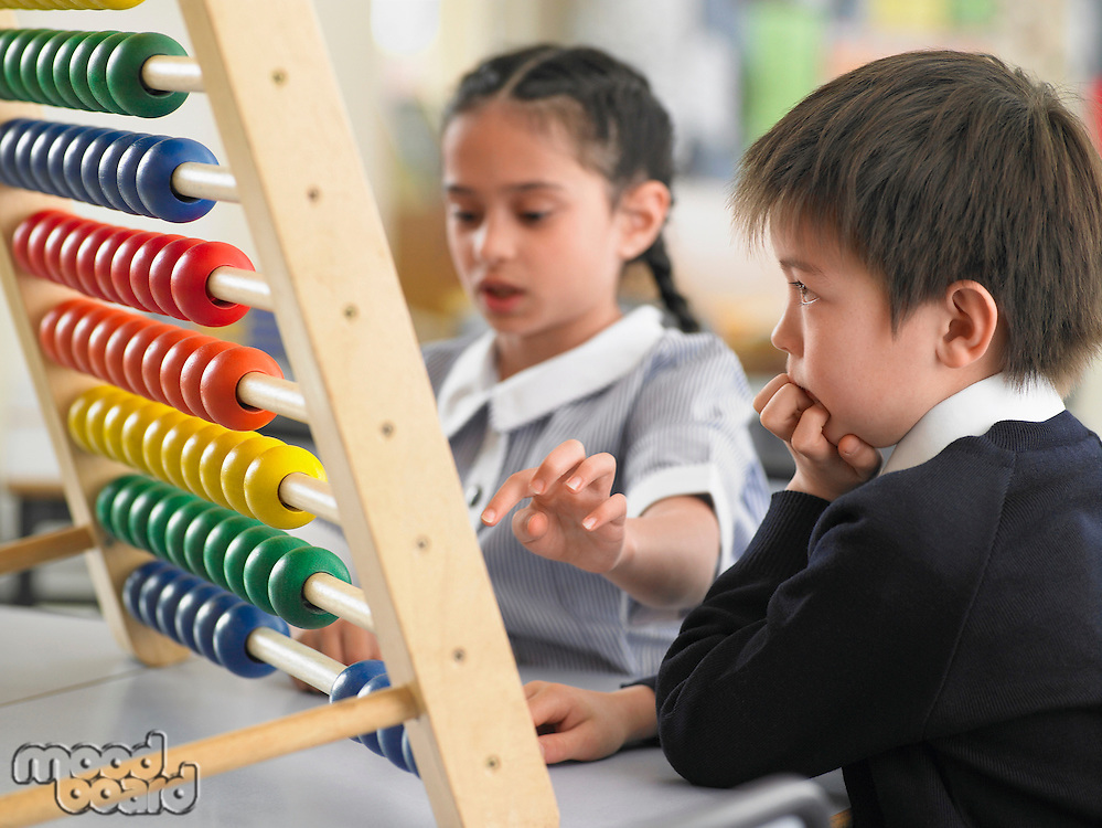 Elementary students using abacus in classroom