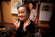 """Sugamo  Harajuku for pensioners, 90-year-old Hisako Yanagida, who chats in between belting out.traditional ballads in a musty karaoke bar called Mukashi no Uta (Songs from the Old Days).  """"Meeting and shopping with people my own age helps stop me.from going senile.""""  The 1km main.shopping street, Jizo Dori, boasts 10 drugs stores and chemists, half a dozen or more outlets selling walking aids, at least two funeral arrangers and a karaoke bar where the song-list stops in the 1970s."""