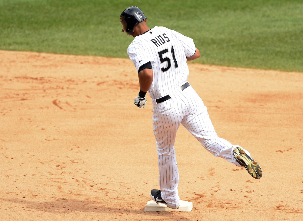 CHICAGO - SEPTEMBER 05:  Alex Rios #51 of the Chicago White Sox rounds second base after hitting a two-run home run  against the Minnesota Twins on September 05, 2012 at U.S. Cellular Field in Chicago, Illinois.  The White Sox defeated the Twins 6-2.  (Photo by Ron Vesely)  Subject:    Alex Rios