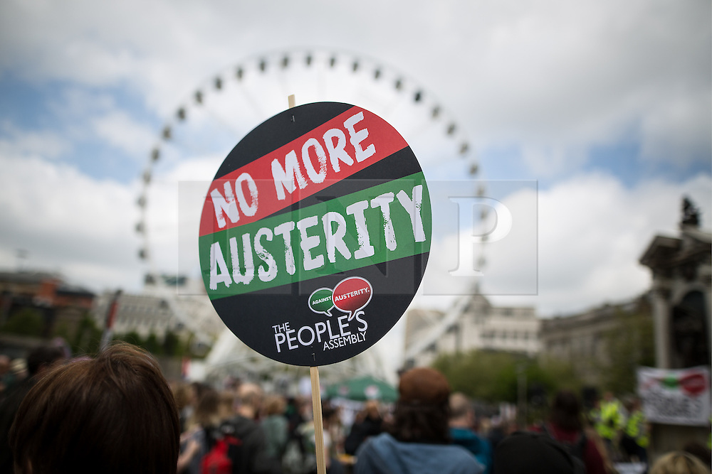 """© Licensed to London News Pictures . 23/05/2015 . Manchester , UK . A demonstration , organised by """" The People's Assembly """" , against austerity in Piccadilly Gardens in Central Manchester , attended by approximately 2000 people . Photo credit : Joel Goodman/LNP"""