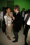 Thandie Newton and Christopher Bailey, Burberry celebrates the opening of the Hockney exhibition and their 150th anniversary with a party at the National Portrait Gallery. 11 October 2006. -DO NOT ARCHIVE-© Copyright Photograph by Dafydd Jones 66 Stockwell Park Rd. London SW9 0DA Tel 020 7733 0108 www.dafjones.com