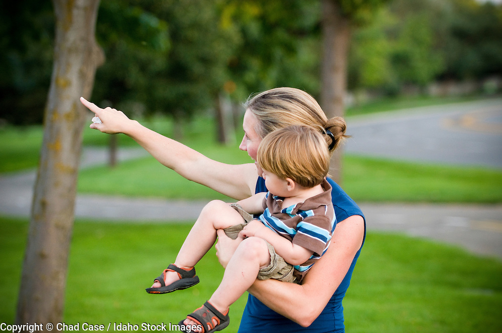 Idaho. Boise. Baggley Park. Mother son looking at birds. MR