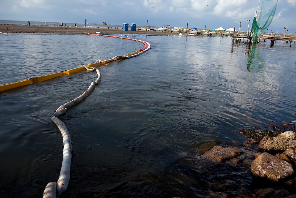 Oil booms are seen near the shoreline on June 24, 2010 where B.P. oil spill has reached land in Grand Isle, LA.