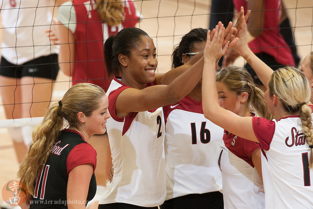 November 25, 2006; Stanford, CA, USA; Stanford Cardinal libero Jessica Fishburn (11), middle blocker Janet Okogbaa (2), middle blocker Foluke Akinradewo (16), setter Bryn Kehoe (4), and outside hitter Kristin Richards (10) celebrate during the game against the Washington State Cougars at Maples Pavilion. The Cardinal defeated the Cougars 30-27, 30-23, 30-18.
