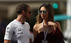 McLaren Honda driver Jenson Button arrives at the circuit with his girlfriend Brittny Ward during practice at Yas Marina Circuit, Abu Dhabi. PRESS ASSOCIATION Photo. Picture date: Friday November 25, 2016. See PA story AUTO Abu Dhabi. Photo credit should read: David Davies/PA Wire. RESTRICTIONS: Editorial use only. Commercial use with prior consent from teams.