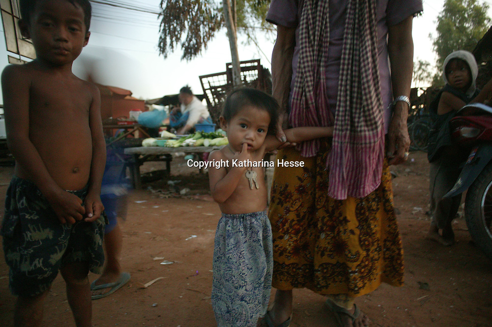 SIEM REAP, NOVEMBER-27: a child stands next to his mother in SiemReap, November 27, 2006, Cambodia...One of the world's poorest countries, the majority of Cambodia's population (about 74%) is employed in agriculture...