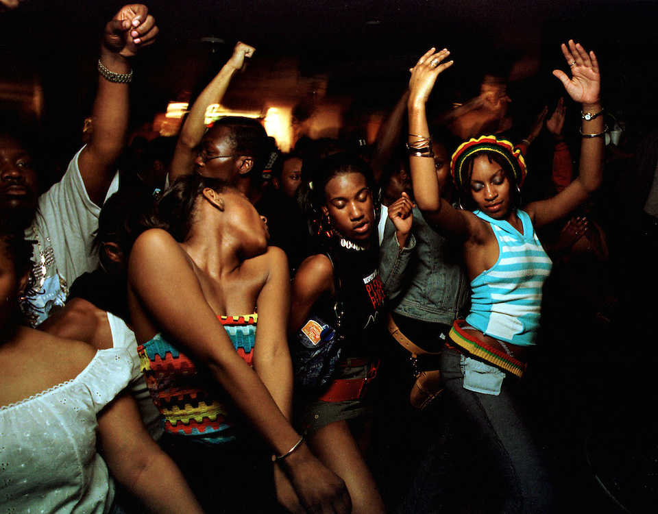 &quot;Groove&quot; - Marlow Heights, MD, Circa 2002 - by Andr&eacute; Chung<br /> Revelers dance at a go-go, D.C.'s homegrown percussion heavy live band dance party.  Go-go is a sub-genre associated with funk that originated in the Washington, D.C., area during the mid- 1960's to late-1970s. It remains primarily popular in the area as a uniquely regional music style. Go-Go remains appealing because it never attempts to be slick, pretty, polished, or accepted on a larger level. For over 20 years it has flourished on a regional level. No one familiar with it doubts for a second that it will continue to survive.