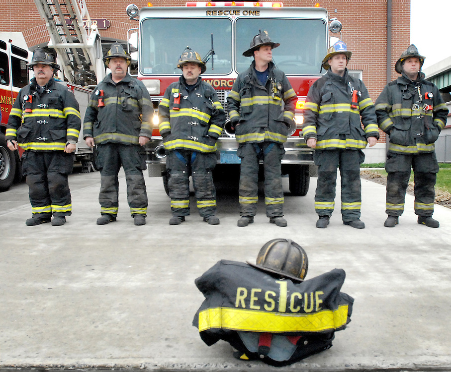 Firefighters stand behind Jon Davies' turn out gear before the funeral began at the Franklin St. fire station. (CHRIS CHRISTO)