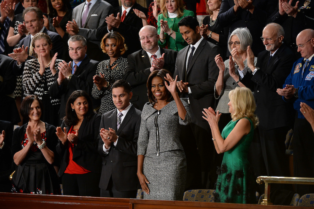 1/20/15 {time} -- Washington, DC, U.S.A  -- Front Row: Carolyn Reed, Ana Zamora, Anthony Mendez, First Lady Michelle Obama, center, Second Lady Dr. Jill Biden, right.  Second Row: Victor Fugate (white male glasses center), Dr. Pranav Shetty, Judy and Alan Gross, astronaut Scott Kelly in the First Lady's box before President Barack Obama delivers the State of the Union address on Tuesday, Jan. 20, 2015 from the House chamber of the United States Capitol in Washington. --    Photo by H. Darr Beiser, USA TODAY staff (Via OlyDrop)