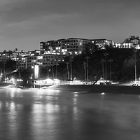 San Clemente California skyline at night black and white panorama photo. San Clemente is a popular beach city in Orange County in Southern California in the United States of America. Panorama photo ratio is 1:3. Copyright ⓒ 2017 Paul Velgos with All Rights Reserved.