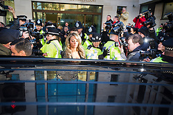 © London News Pictures. 19/12/2013 . TULISA CONTOSTAVLOS (centre) being ushered into a car by police as she  leaves Westminster Magistrates court on London where she faced charges of supplying a class A drug. Former X-Factor judge Tulisa and Mike GLC (real name Michael Coombs)  are accused of supplying a class A drug to an investigative journalist. Photo credit : Ben Cawthra/LNP