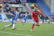 Wigan Athletic Forward, Will Grigg and currently Wigans leading Goal scorer on the ball during the Sky Bet League 1 match between Wigan Athletic and Oldham Athletic at the DW Stadium, Wigan, England on 13 February 2016. Photo by Mark Pollitt.