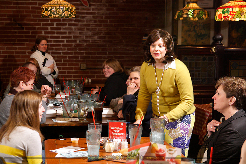 """(from left, standing) Heather Gorby as Halma Grey and Tamra Francis as Maggie Paddock during Mayhem & Mystery's production of """"Game Night Grudge"""" at the Spaghetti Warehouse in downtown Dayton, Monday, March 4, 2013."""